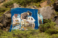 Rock painting of an Inuit mother and childe plus a painting of a Musk Ox