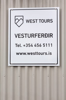Sign for a tour company at Isafjordur