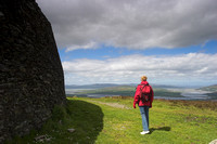 EX0526C-D02819 : A tourist at Grianan Ailligh,  an Iron Age hill fort built on a Neolithic burial mound in Co. Donegal, Ireland.