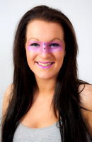 Young brunette model with pink make-up round her eyes
