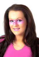 Brunette model with pink make-up round her eyes.