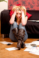 Young woman worried about her debts