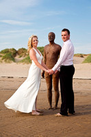Wedding couple with one of Antony Gormley's statues.