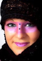 Pink make-up round the eyes and wearing a scarf