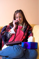 [EY0219C-D00790] Teenage girl with a cold or flu on the telphone