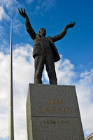 EX0517A-D01671 : Statue of Jim Larkin, the trade union leader.  O'Connell Street, Dublin.  In background can be seen the Spire of Dublin.