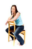 [EY0219B-D00575] A teenage girl sitting on a chair