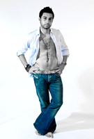 FA0718C-E07965-2 : A young man in jeans and an open shirt