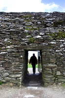 EX0526C-D02815 : A tourist exits Grianan Ailligh,  an Iron Age hill fort built on a Neolithic burial mound in Co. Donegal, Ireland.
