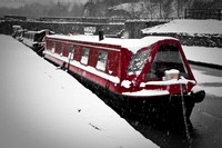 Canal boats in the snow.