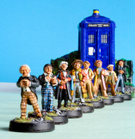 Models of the first eight Doctors in front of the TARDIS