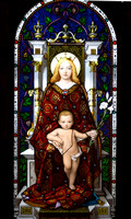 A stained glass window showing the Madonna and Child.