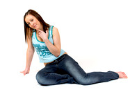 EY0219B-D00567 : A teenage girl sitting on the floor