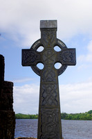 EX0526B-D02772 : A celtic cross at Donegal Friary and cemetery.  In the background is Donegal Bay.