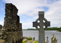 EX0526B-D02768 : A celtic cross at Donegal Friary and cemetery.  In the background is Donegal Bay.