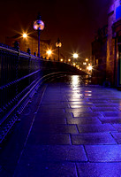 EY0118A-D00275 : Blue lights reflecting on a wet pavement