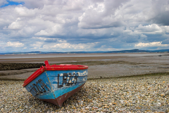 A boat on the beach.  A view of Morecambe Bay with the tide out.