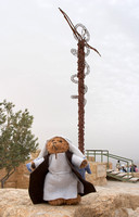 EW0514F-D02611 : Beni, a teddy bear as moses on Mount Nebo, Jordan, where Moses died having seen the Promised Pand.