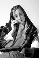 [EY0219C-D00795] Teenage girl with a cold or flu on the telphone