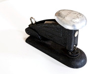 An antique stapler
