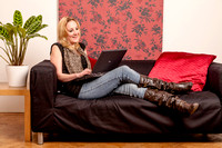 Young woman on a sofa using a laptop